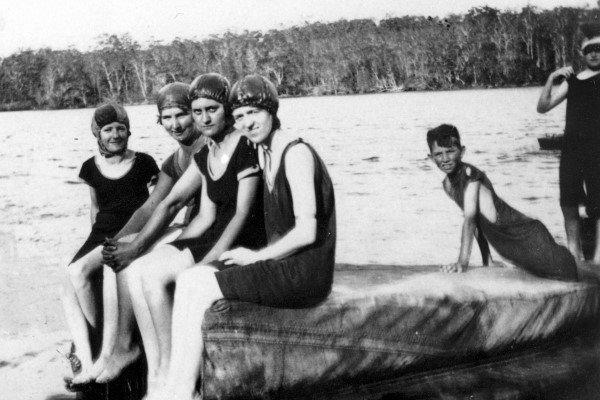 Young people enjoy a swim while holidaying at the King family camp at Coochin Creek near Caloundra, ca 1921