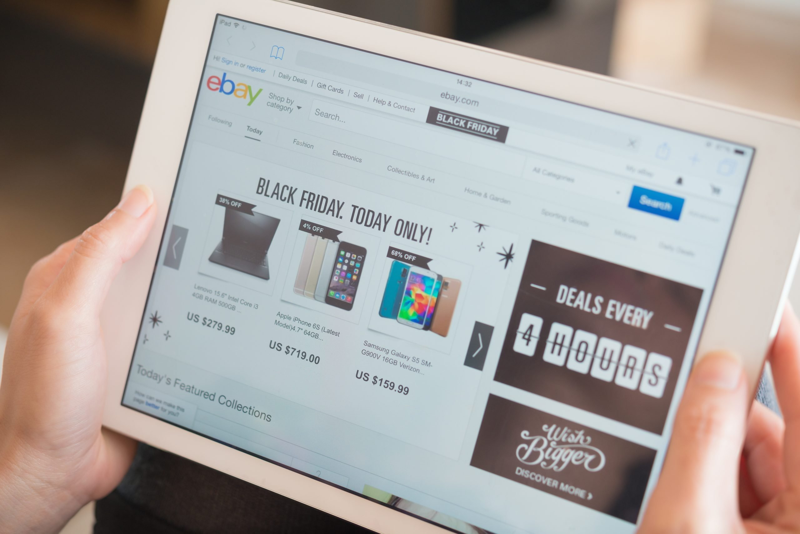 young women shopping through tablet on Ebay