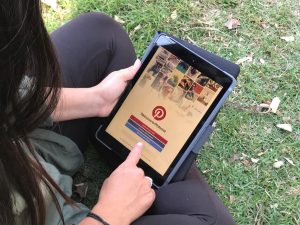 Person using Pinterest outdoors on an iPad